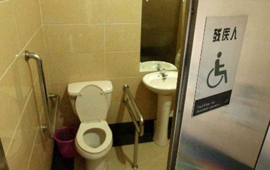 A wheelchair-accessible public toilet facility